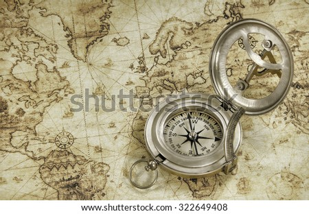 compass on a old world map - stock photo