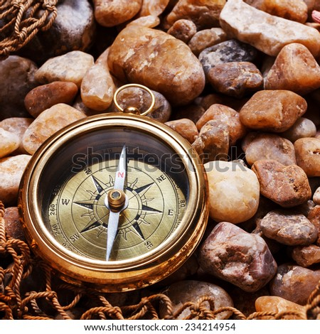Compass on a stone  - stock photo
