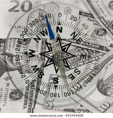 Compass on banknote for financial direction,concept of business planning and finance - stock photo