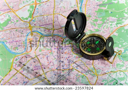 Compass on city map background