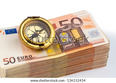 compass on euro banknotes, symbolic photo for europe, monetary union and the outlook for the european currency - stock photo