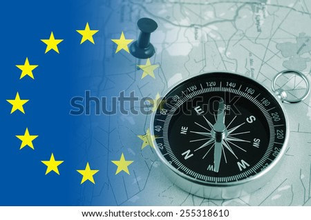 Compass on map and europe union flag - stock photo