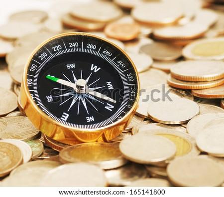 compass on money background - stock photo