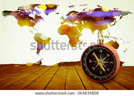 compass on old perspective wooden floor with world map on bokeh light  background - stock photo