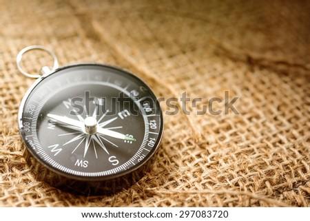 Compass on sackcloth - stock photo