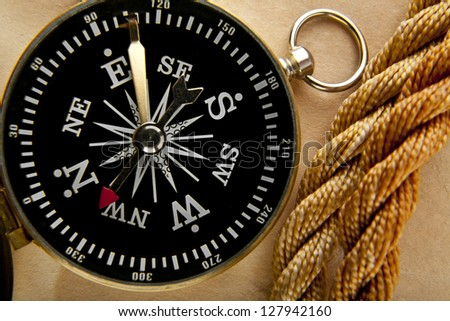 compass on the background of an old paper - stock photo