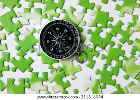 compass on the green puzzle
