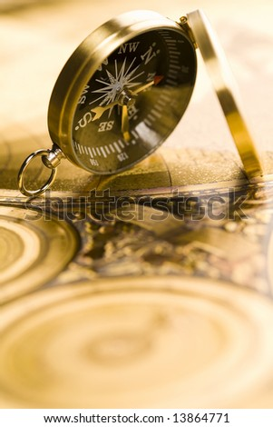 Compass on the old paper background - stock photo