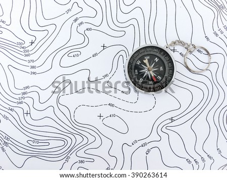 Compass on Topographic Map. - stock photo