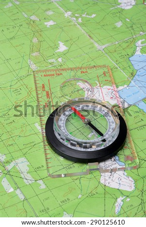 Compass on topographic map. Concept of travel. - stock photo