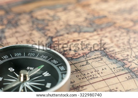 Compass on vintage map. - stock photo