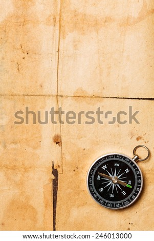 compass on vintage paper - stock photo