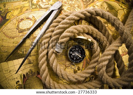 Compass over old map - stock photo