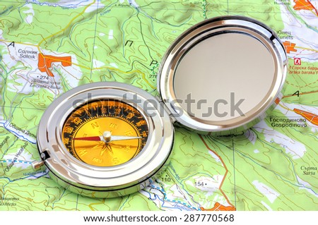 Compass over the map - stock photo