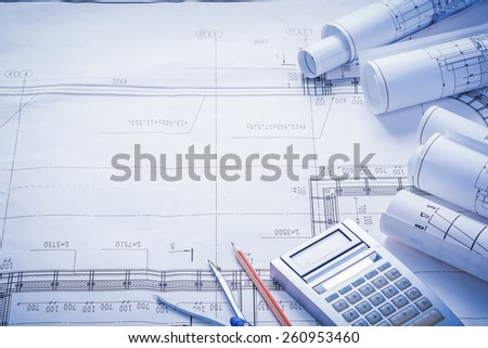 compass pencil calculator rolled blueprints with big place for text construction concept  - stock photo