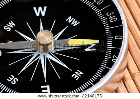 Compass showing north on a brown background - stock photo