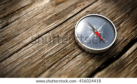 Compass showing the north on a wooden table. Close up view. Objective concept. 3D Rendering - stock photo