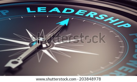 Compass with needle pointing the word leadership with blur effect plus blue and black tones. Conceptual image for illustration of leader motivation - stock photo