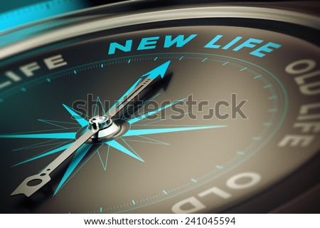 Compass with needle pointing the word new life, concept image to illustrate change motivation concept. - stock photo