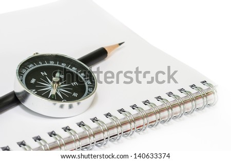 Compass with the book  on white background. - stock photo