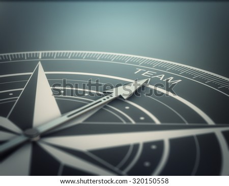 Compass with the needle pointing the word team, black background. Conceptual realistic 3D render image with depth of field blur effect. Concept for business solutions. - stock photo