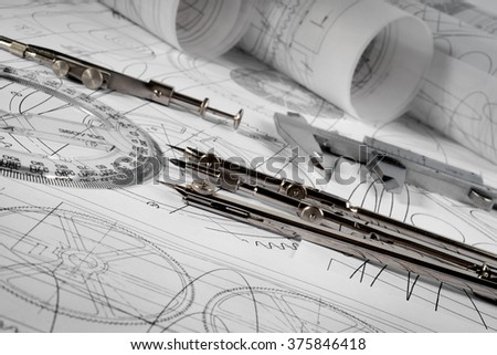compasses and blueprint - stock photo