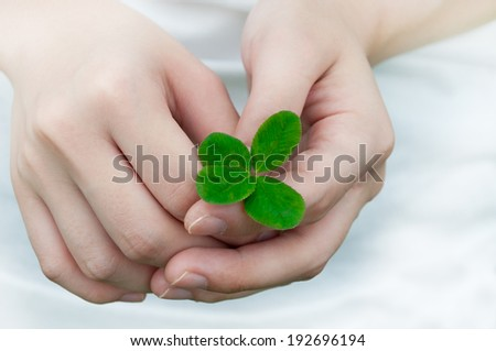 Compassion with a Four Leaf Clover  - stock photo