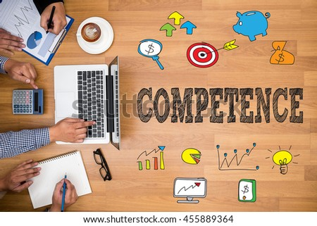 COMPETENCE  ( Skill Ability Proficiency Accomplishment) Business team hands at work with financial reports and a laptop - stock photo