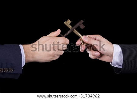 Competition concept on real estate services - Two hands fighting with two key - stock photo