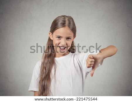 Competition failed. Portrait sarcastic teenager girl showing thumb down gesture happy someone made mistake lost isolated grey background. Human emotion facial expression feeling attitude body language - stock photo
