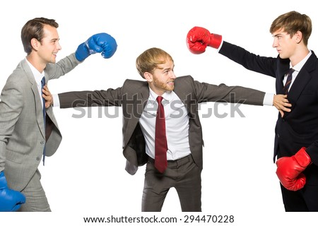 competition of two businessmen wearing boxing gloves with mediator isolated in white - stock photo