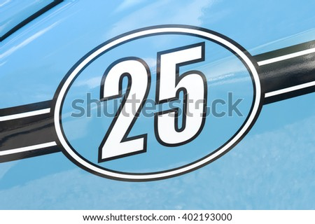 competition race number 25 on a light blue metallic panel - stock photo