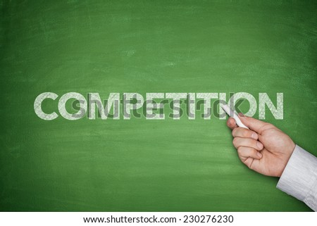 Competition word on green blackboard with hand