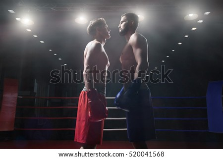Competitions athletes in boxing ring