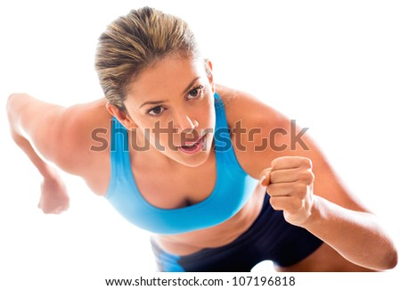 Competitive female athlete running - isolated over a white background