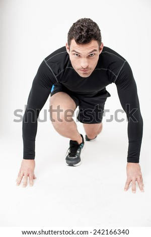 Competitive male athlete getting ready to run