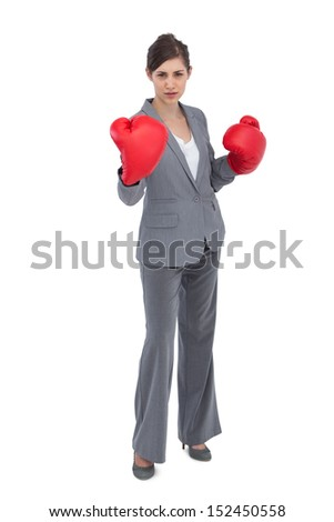 Competitive woman with red boxing gloves on white background - stock photo