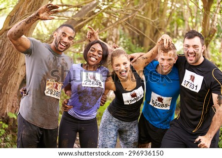 Competitors celebrate completing an endurance sports event - stock photo