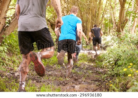 Competitors running in a forest at an endurance event - stock photo