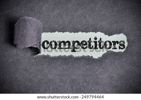 Competitors word under torn black sugar paper  - stock photo