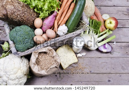 compilation of organic vegetables and milk products - stock photo