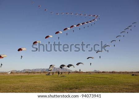 Compilation of Skydivers approaching for landing - stock photo