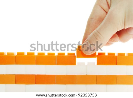 compleeting the wall on a white background