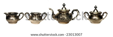 Complete antique silver tea set, isolated on white - stock photo