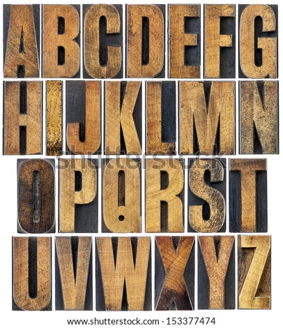 complete English alphabet - a collage of 26 isolated vintage wood letterpress printing blocks, scratched and stained by ink - stock photo