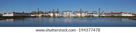 complete Panorama of  Nymphenburger Castle in Munich with clear blue sky and lake in the foreground - stock photo