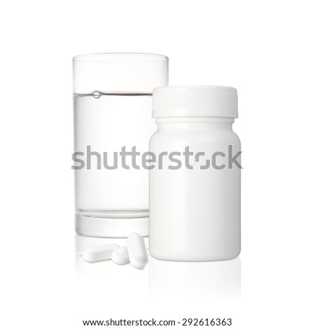 Complete prescription set up showing a glass of water, a white blank plastic medicine bottle and several white pills