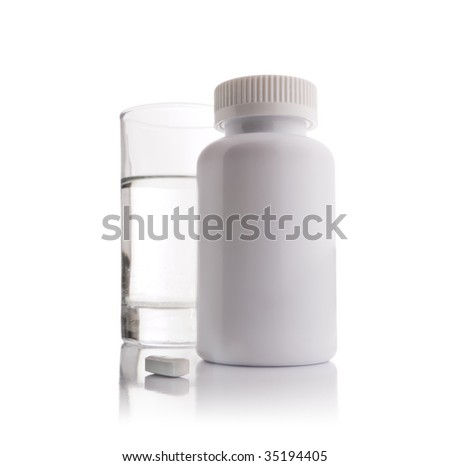 Complete prescription set up showing a glass of water, a white blank plastic medicine bottle and one white pill - stock photo