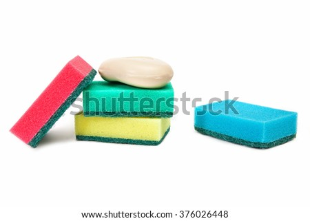 Complete set of economic sponges and bar of soap are isolated on a white background