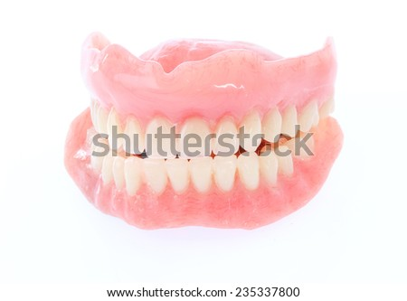 Complete Set of False Teeth Isolated on White  - stock photo